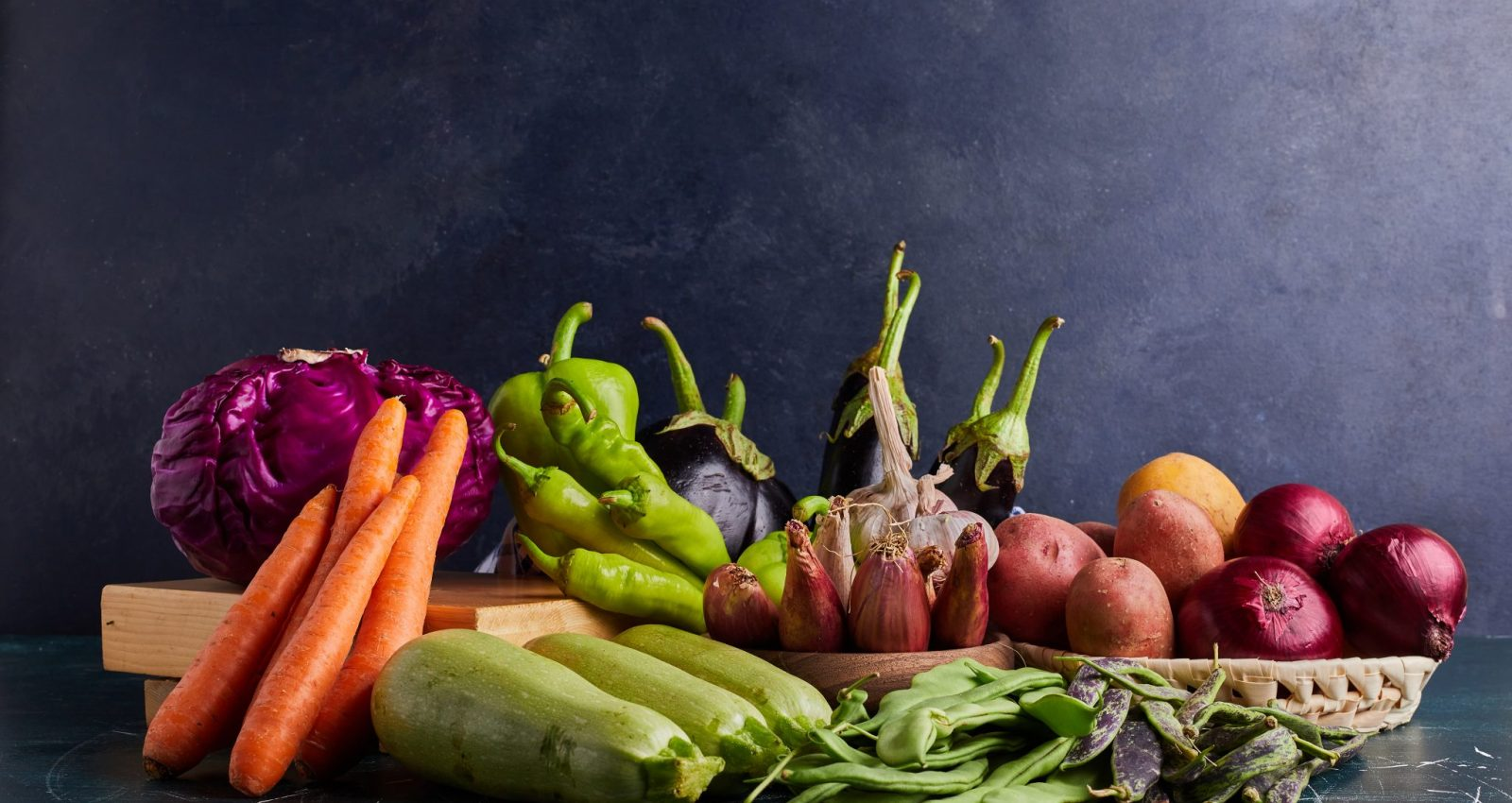 Variety of vegetables isolated on blue background . High quality photo